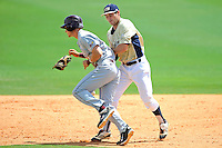 22 April 2012:  UALR center fielder Cameron Bentley (3) collides with FIU infielder/outfielder Tyler James Shantz (5), causing him to lose his glove and the ball, as the University of Arkansas Little Rock Trojans defeated the FIU Golden Panthers, 7-6, at University Park Stadium in Miami, Florida.