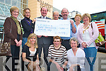 Colin Millar who presented a cheque for EUR 5,000 Tadhg Kelleher, the national branch of Aware in the Killarney Outlet Centre  on Saturday. Also pictured are Bridget O'Neill, Veronica Hager, Sheila Fogarty, Maire Ni Iarlaithe, Ted O'Shea, Helen McCarthy, Ursala Daly and Eileen O'Keeffe..   Copyright Kerry's Eye 2008