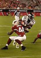 Aug. 31, 2006; Glendale, AZ, USA; Arizona Cardinals cornerback (44) Darrell Hunter tackles Denver Broncos running back (20) Mike Bell at Cardinals Stadium in Glendale, AZ. Mandatory Credit: Mark J. Rebilas
