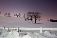 Trees stand in snow on Horsebarn Hill near the University of Connecticut campus in Storrs, Connecticut, USA.