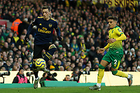 1st December 2019; Carrow Road, Norwich, Norfolk, England, English Premier League Football, Norwich versus Arsenal; Mesut Ozil of Arsenal controls the ball - Strictly Editorial Use Only. No use with unauthorized audio, video, data, fixture lists, club/league logos or 'live' services. Online in-match use limited to 120 images, no video emulation. No use in betting, games or single club/league/player publications