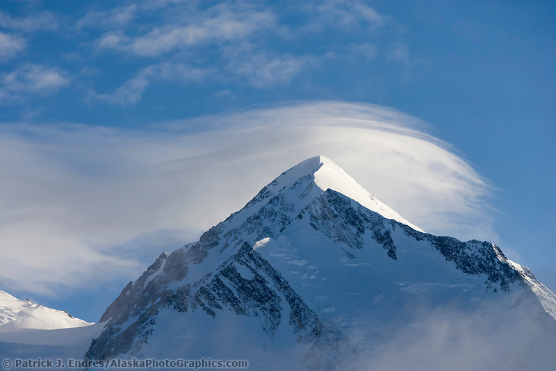 Lenticular clouds hang over Mount Denali's north summit.