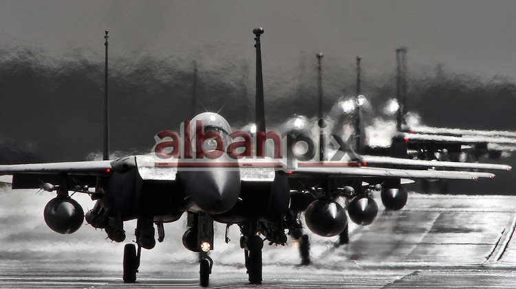 F15 Eagles line up on the runway at RAF Lakenheath in Suffolk ready for take off.