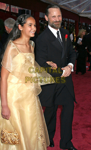 VIGGO MORTENSEN & GUEST .The 80th Annual Academy Awards Arrivals held at the Kodak Theatre, Hollywood, California, USA..February 24th, 2008.oscars full length black suit jacket yellow beige dress beard facial hair.CAP/ADM/RE.©Russ Elliot/AdMedia/Capital Pictures.