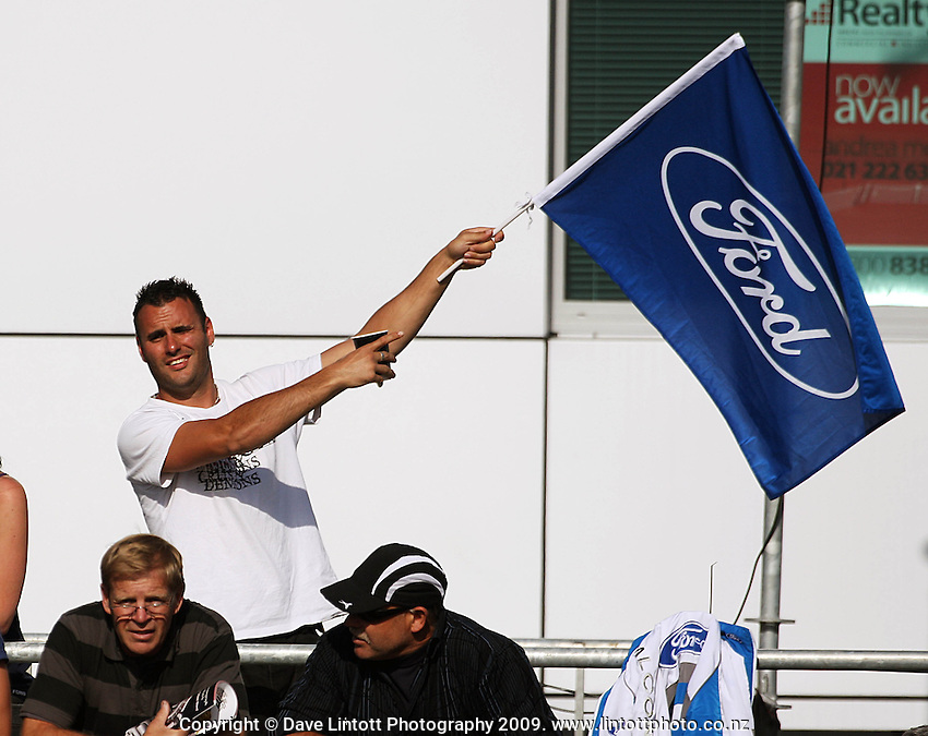 A Ford fan waves the flag during day two of the Aussie V8 Supercars Round Two, Hamilton 400, Frankton, Hamilton, New Zealand on Saturday, 18 April 2009. Photo: Dave Lintott / lintottphoto.co.nz