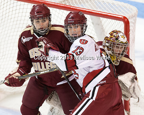 Lexi Bender (BC - 21), Kalley Armstrong (Harvard - 13), Corinne Boyles (BC - 29) - The Boston College Eagles defeated the Harvard University Crimson 2-1 in the 2013 Beanpot opening round on Tuesday, February 5, 2013, at Matthews Arena in Boston, Massachusetts.