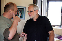 Polish men having an animated one-on-one conversation age 58 and 65. Zawady Central Poland