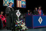 Ronald Caltabiano, dean of the School of Music, far left, reads a citation for John Corigliano, a Grammy Award-winning composer, center, as he receives an honorary degree Saturday, June 10, 2017, during the DePaul University School of Music and The Theatre School commencement ceremony at the Rosemont Theatre in Rosemont, IL. (DePaul University/Jeff Carrion)
