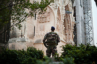 A soldier on watch beside the entrance to the cathedral of Notre-Dame de Reims, Reims, France, 11 November 2015. The French army maintains a watch outside the building around the opening and closing hours of the cathedral every day.