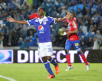 BOGOTA -COLOMBIA- 25-08-2013. Erick Moreno de Millonarios  celebra su gol  contra el Deportivo Pasto    ,  partido correspondiente a la  sexta fecha de la Liga Postobón segundo semestre disputado en el estadio Nemesio Camacho El Campin     / Millionaires Eric Moreno celebrates his goal against Deportivo Pasto, game in the sixth round of the second half Postobón League match at the Estadio Nemesio Camacho El Campin . Photo: VizzorImage /Felipe Caicedo  / STAFF