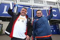 Two Swansea fans before the Barclays Premier League match between Leicester City and Swansea City played at The King Power Stadium, Leicester on April 24th 2016