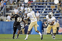 17 September 2011:  FIU defensive tackle Jerrico Lee (98) puts pressure on UCF quarterback Jeff Godfrey (2) in the second quarter as the FIU Golden Panthers defeated the University of Central Florida Golden Knights, 17-10, at FIU Stadium in Miami, Florida.