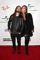 LOS ANGELES, CA - FEBRUARY 10: Tom Payne, Jennifer Åkerman, at theUniversal Music Group Grammy After party celebrating th 61st Annual Grammy Awards at The Row in Los Angeles, California on February 10, 2019. Credit: Faye Sadou/MediaPunch