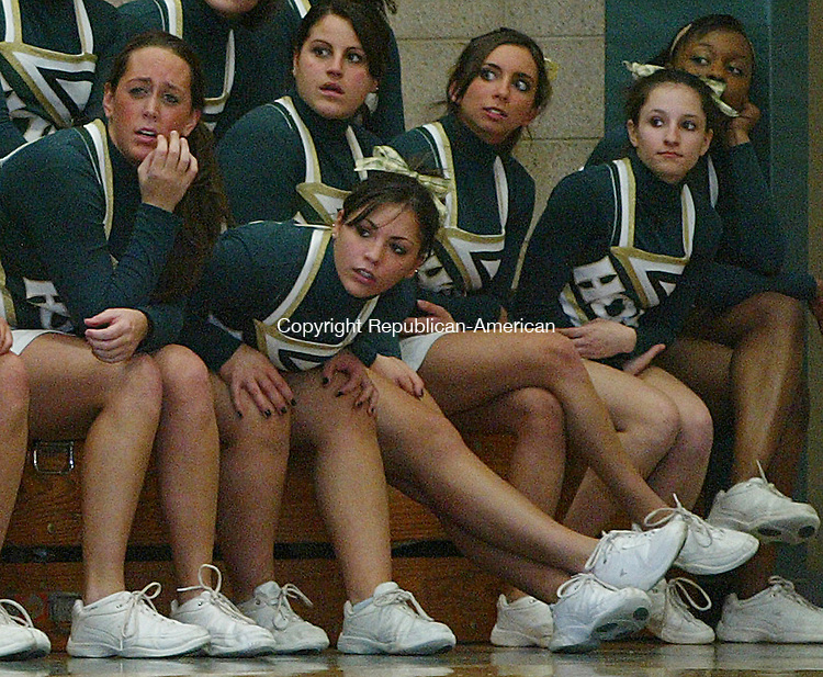 Holy Cross' cheerleaders watch the final moments of the game in Division LL second round action at Holy Cross High School Wednesday night.  The Crusaders were defeated by the Hornets 58-59  Michael Kabelka Republican / American.