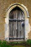 Small doorway wooden door into Ramsholt church, Suffolk, England, UK