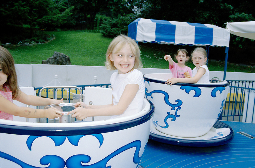 Dakota Fanning at the amusement park in Central Park, NYC, 2003