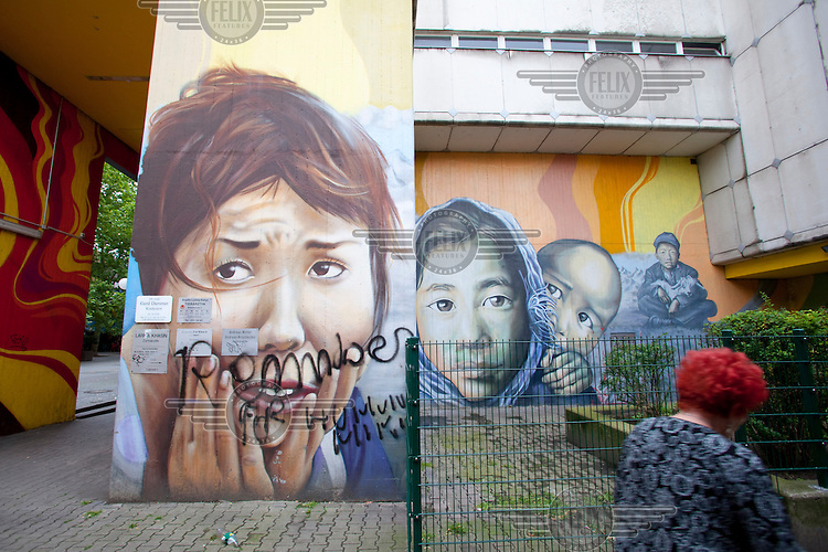Murals and graffiti on a housing estate in Berlin's Kreuzberg district..
