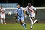 18 October 2013: North Carolina's Tyler Engel (8) and Skylar Thomas (CAN) (3). The University of North Carolina Tar Heels hosted the Syracuse University Orangemen at Fetzer Field in Chapel Hill, NC in a 2013 NCAA Division I Men's Soccer match. UNC won the game 1-0.