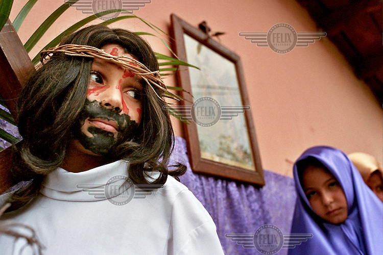 Easter in Comayagua, a small but deeply religious town near the capital. Every year the town takes part in the Passion of the Christ, a procession where the children of the town reinact all the stations of the cross, culminating in the crucifixion.