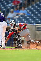 Frisco Rough Riders catcher Tomas Telis (13) retrieves a blocked ball in the dirt during the first game of a doubleheader against the Tulsa Drillers on May 29, 2014 at ONEOK Field in Tulsa, Oklahoma.  Frisco defeated Tulsa 13-4.  (Mike Janes/Four Seam Images)