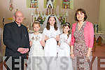 Making their First Holy Communion was E?rina Cotter, Ni?amh Brosnan and Bro?nagh Browne from Loughfrouder NS, pictured here with Fr Mangan and Elizabeth Lane last Saturday in Knocknagoshal.
