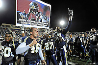 27 November 2010:  FIU's Chris Edwards (60), Michael Davies (46), Jose Cheeseborough (27) and Paul Crawford (92) celebrate winning the game and the Sun Belt Conference Championship after the FIU Golden Panthers defeated the Arkansas State Red Wolves, 31-24, at FIU Stadium in Miami, Florida.