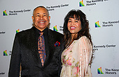 Percussionist Ralph Johnson of Earth, Wind and Fire and his wife, Susan Johnson, arrive for the formal Artist's Dinner honoring the recipients of the 42nd Annual Kennedy Center Honors at the United States Department of State in Washington, D.C. on Saturday, December 7, 2019. The 2019 honorees are: Earth, Wind & Fire, Sally Field, Linda Ronstadt, Sesame Street, and Michael Tilson Thomas.<br /> Credit: Ron Sachs / Pool via CNP