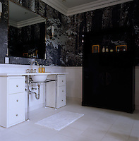 The bathroom is furnished with lacquered cabinets designed by Shamir Shah