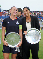 Freedom forward Abby  Wambach receiving the induction of Hall of Freedom on behalf of David Valone former Assistant coach of the Freeedom and Steffi Jones (former Freedom player)   The LA Sol defeated the Washington Freedom 1-0 at the Maryland Soccerplex, Sunday July 5, 2009.