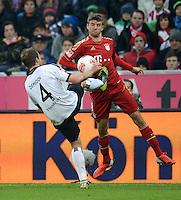 FUSSBALL   1. BUNDESLIGA  SAISON 2012/2013   11. Spieltag FC Bayern Muenchen - Eintracht Frankfurt    10.11.2012 Vadim Demidov (li, Eintracht Frankfurt) gegen Thomas Mueller (FC Bayern Muenchen)