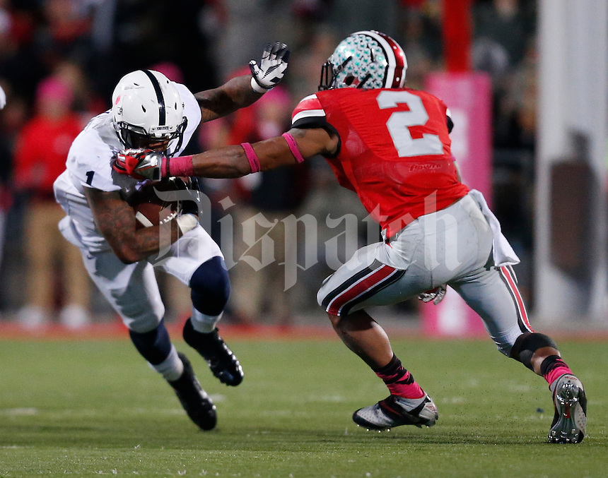 Penn State Nittany Lions running back Bill Belton (1) is nabbed by Ohio State Buckeyes linebacker Ryan Shazier (2) during Saturday's NCAA Division I football game at Ohio Stadium on October 26, 2013. (Barbara J. Perenic/The Columbus Dispatch)