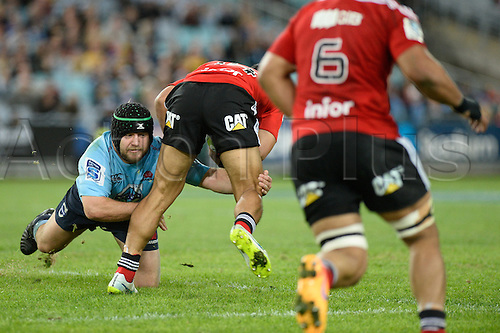 23.05.2015.  Sydney, Australia. Super Rugby. NSW Waratahs versus the Crusaders. Waratahs prop Benn Robinson brings down his player with a low tackle. The Waratahs won 32-22.