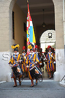 Vatican Swiss Guards hold a commemorative wreath during a celebration of the 1527 Sack of Rome, in the courtyard of the headquarters of the Swiss Guards, at the Vatican, Wednesday, May 6, 2009. On Wednesday afternoon, the Swiss Guards will swear in 32 new recruits. The ceremony is held each May 6 to commemorate the 147 Swiss Guards who died protecting Pope Clement VII during the 1527 Sack of Rome carried out by the mutinous troops of Charles V, Holy Roman Emperor.