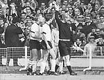 Fussball-Weltmeisterschaft 1966 in England Fussball-Weltmeisterschaft 1966, Endspiel Deutschland - England am 30.7.1966: Deutsche Spieler der Fussball-Nationalmannschaft reklamieren beim Linienrichter Tofik Bachramow (re.) das umstrittene dritte Tor der Englaender. Bachramow winkt ab, und somit verliert Deutschland das WM-Finale nach Verlaengerung 4:2 gegen England. Im Hintergrund die volle Zuschauertribuene. -<br /> <br /> - 30.07.1966<br /> <br /> Es obliegt dem Nutzer zu pr&uuml;fen, ob Rechte Dritter an den Bildinhalten der beabsichtigten Nutzung des Bildmaterials entgegen stehen.<br /> <br /> 1966 FIFA World Cup in England Final at Wembley: Germany 2 - 4 England - Germany players are protesting at linesman Tofik Bachramow against the controversial third goal for England -<br /> <br /> - 30.07.1966<br /> <br /> It is in the duty of the user of the image to clear prior to usage if any Third Party rights preclude the intended use.