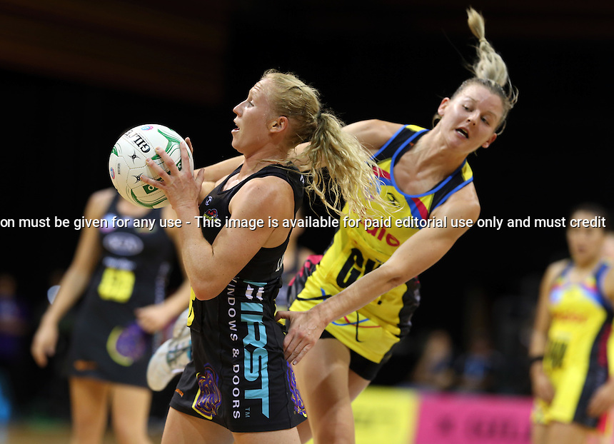 13.05.2013 Magic's Laura Langman and Pulse's Katrina Grant in action during the ANZ Champs netball match between the Magic and Pulse played at Claudelands Arene in Hamilton. Mandatory Photo Credit ©Michael Bradley.