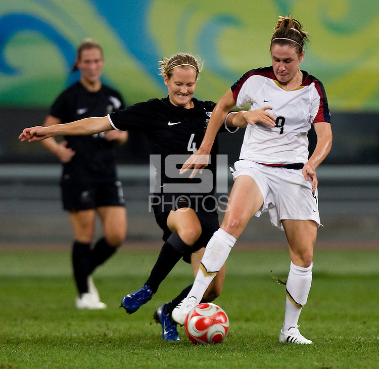 USWNT midfielder (9) Heather O'Reilly fights for the ball with New Zealand midfielder (4) Katie Hoyle while playing at Wulihe Stadium.  The USWNT defeated New Zealand, 4-0, during the 2008 Beijing Olympics in Shenyang, China.  With the win, the USWNT won group G and advanced to the semifinals.
