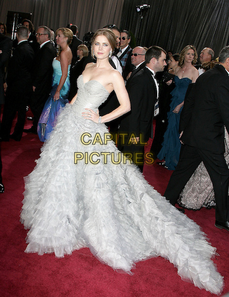 Amy Adams (wearing Oscar de la Renta).85th Annual Academy Awards held at the Dolby Theatre at Hollywood & Highland Center, Hollywood, California, USA..February 24th, 2013.oscars full length dress gown powdery blue fluffy layers layered feathery tulle side strapless train side hands on hips.CAP/ADM.©AdMedia/Capital Pictures.
