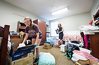 Mississippi State sophomore Roselynn H. Nelson, front, and freshman Katherine M. Mialaret unpack belongings in their room at Hurst Hall during the university's annual MVNU2MSU move-in day event for new and returning students. Nelson is an electrical engineering major from Brandon, and Mialaret is a mechanical engineering major from Metairie, Louisiana.<br />  (photo by Megan Bean / &copy; Missis sippi State University)