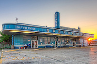 A lone passenger waits for the first bus at sunrise at the historic Greyhound Bus Station in Jackson, Tennessee.  The station, built in 1938, is one of the oldest bus stations in active use, and is listed in the National Register of Historic Places.