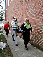 CHARLOTTESVILLE, VA - FEBRUARY 14: From right, Yeardley Love's mother Sharon Love and sister Lexie are escorted with family members to the Charlottesville Circuit courthouse for the George Huguely trial. Huguely was charged in the May 2010 death of his girlfriend Yeardley Love. She was a member of the Virginia women's lacrosse team. Huguely pleaded not guilty to first-degree murder. (Credit Image: © Andrew Shurtleff)