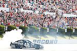 LONG POND, PA - Jimmie Johnson, driver of the #48 Lowes Chevrolet, celebrated after winning the NASCAR Sprint Cup Series Party in the Poconos 400 at the Pocono International Raceway on Sunday, June 9, 2013 in Long Pond, PA.
