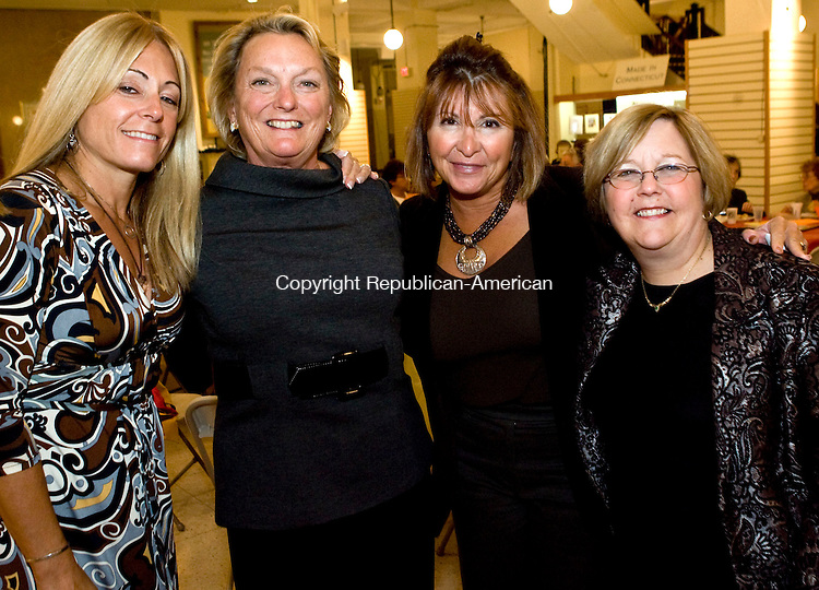 WATERBURY, CT - 23 OCTOBER 2008 -102308JT14--<br /> From left, Karin Marinaro with Literacy Volunteers of Greater Waterbury co-president Katherine Berman, board member Cindy Sherman, and co-president Mary Ellen Hadelman at the LIteracy Volunteers of Greater Waterbury's Scrabble Challenge on Thursday, Oct. 23 at the Howland-Hughes Center in Waterbury. The theme of the event was Fahrenheit 451. <br /> Josalee Thrift / Republican-American