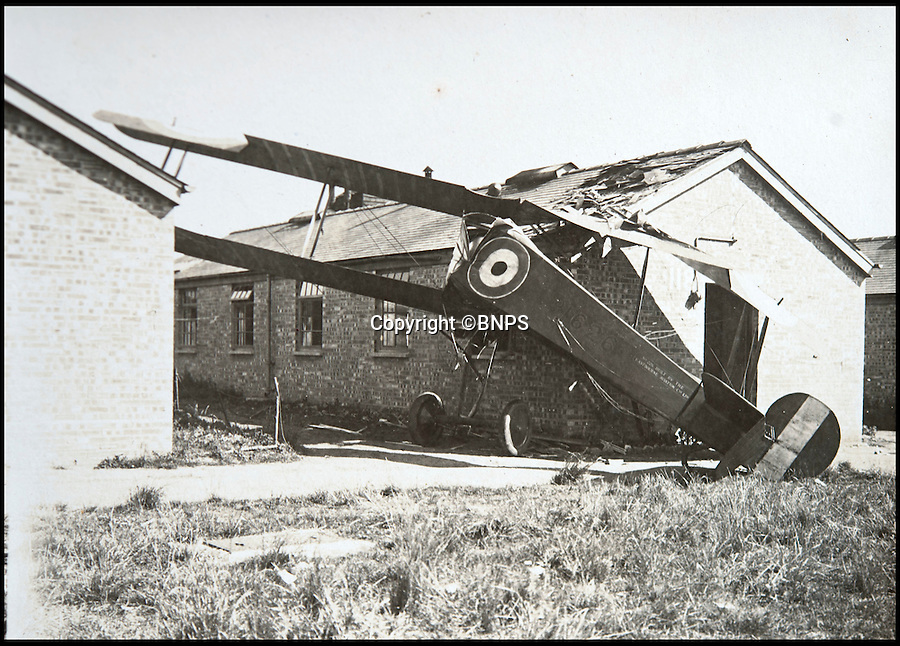 BNPS.co.uk (01202 558833)<br /> Pic: C&TAuctions/BNPS<br /> <br /> Faliure to stop ended with this unfortunate collision with a building..<br /> <br /> Those not so magnificent men in their flying machines...<br /> <br /> A newly discovered album of of photographs from the First War illustrates the difficulties and dangers of the earliest days of flight.<br /> <br /> Thought to have been collected by an unknown officer at the RNAS school of flying at Cranwell during the war, the album catalogues the thrills and spills of a time before health and safety.<br /> <br /> Multiple collisions, perilous carrier take off's, impacts with phone lines, random trees and even buildings are all featured - as well as a visit from the King and Queen.<br /> <br /> C&T auctions are selling the unique album on Wednesday 30th March.