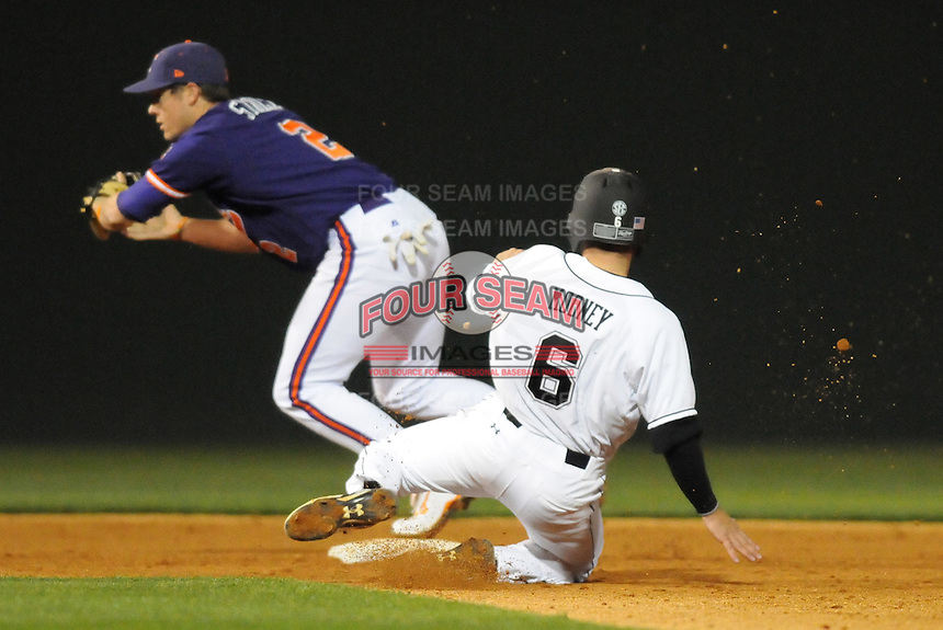 Second baseman Jason Stolz (2) of the Clemson Tigers  makes a force out against Peter Mooney (6) of South Carolina Gamecocks in the fifth inning on Tuesday, March 8, 2011, at Fluor Field in Greenville, S.C.  Photo by Tom Priddy / Four Seam Images