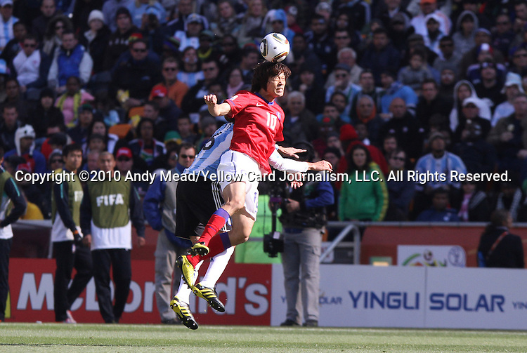 17 JUN 2010: Park Chu Young (KOR) (10) and Gabriel Heinze (ARG) (6). The Argentina National Team defeated the South Korea National Team 4-1 at Soccer City Stadium in Johannesburg, South Africa in a 2010 FIFA World Cup Group E match.