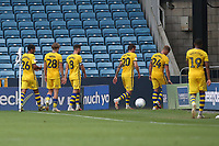 Swansea players leave the field near the corner flag at half-time to use alternative changing room facilities during Millwall vs Swansea City, Sky Bet EFL Championship Football at The Den on 30th June 2020