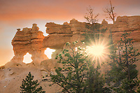 Sunburst through rock arches. Bryce  National Park, Utah