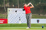 Yumi Kudo of Japan tees off at tee one during the 9th Faldo Series Asia Grand Final 2014 golf tournament on March 18, 2015 at Mission Hills Golf Club in Shenzhen, China. Photo by Xaume Olleros / Power Sport Images