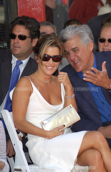 LISA MARIE PRESLEY & comedian JAY LENO at the Grauman's Chinese Theatre, Hollywood, where her boyfriend Nicolas Cage had his hand & footprints set in cement. His new movie, Captain Corelli's Mandolin, had it's US premiere last night..14AUG2001.  © Paul Smith/Featureflash