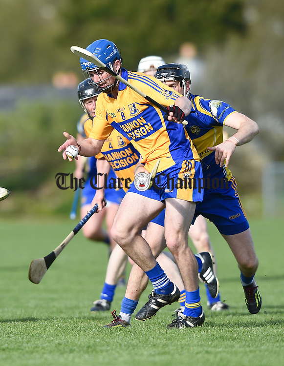 Alex Morey of Sixmilebridge in action against Colin Ryan of Newmarket during their Clare Champion Cup game in Sixmilebridge. Photograph by John Kelly.